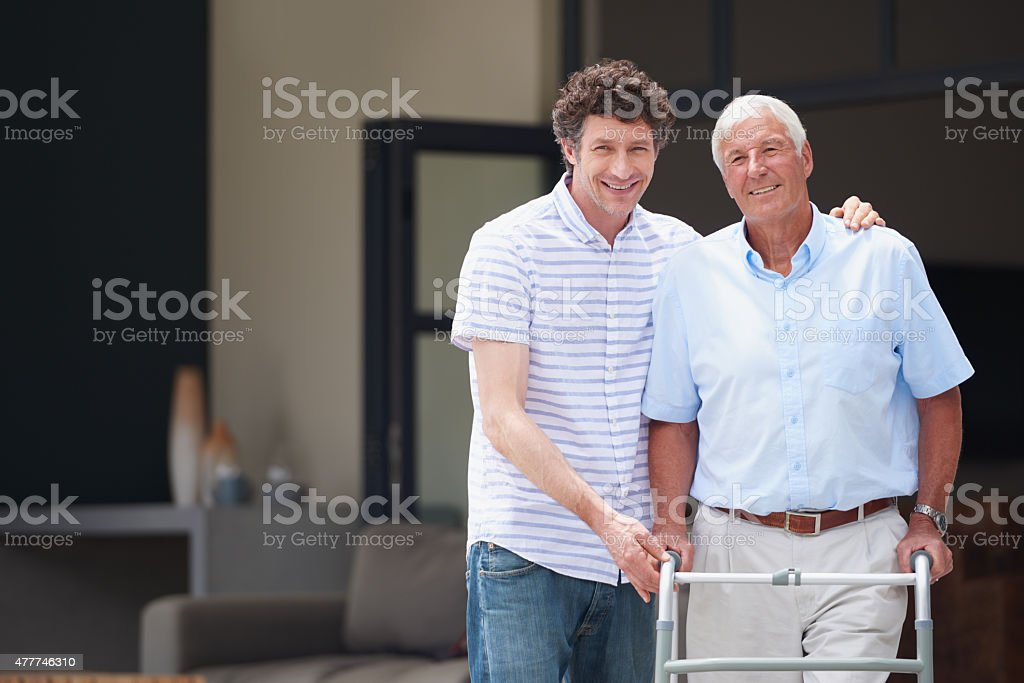 Taking good care of his dad stock photo