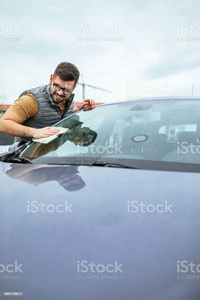 Taking good care of his possessions - Royalty-free Adult Stock Photo