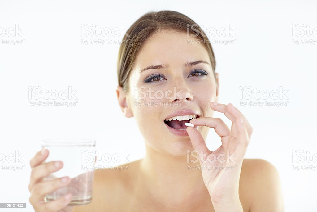 Taking her daily vitamins stock photo