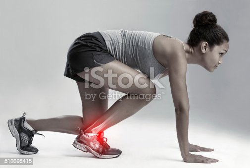 512698489 istock photo Taking her game, and the pain, up a notch 512698415
