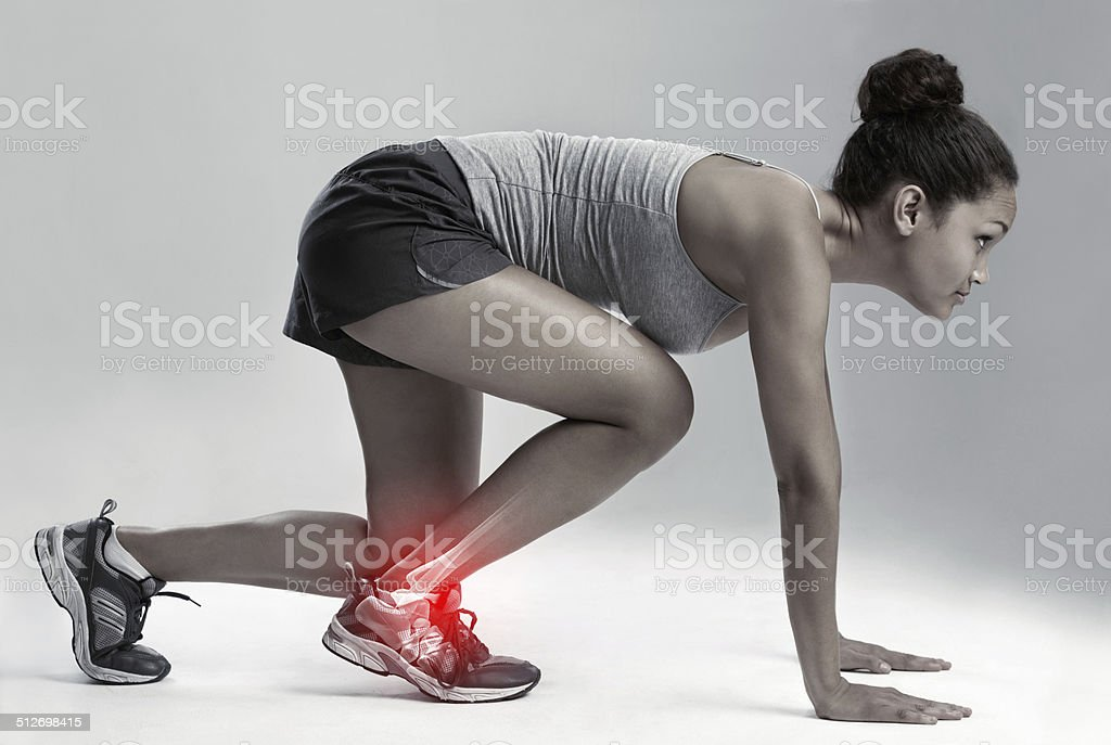 Taking her game, and the pain, up a notch stock photo