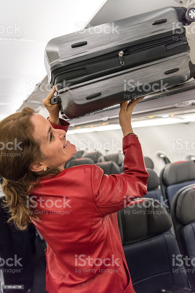 taking her suitcase stock photo