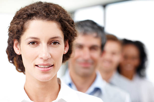 taking her team to the top - row of heads stock photos and pictures
