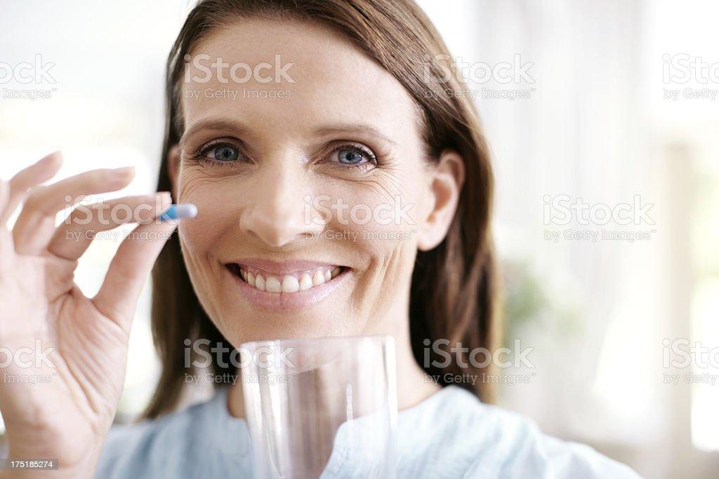 Taking her vitamins stock photo