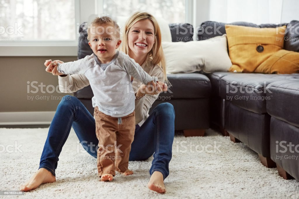 Taking his first steps stock photo
