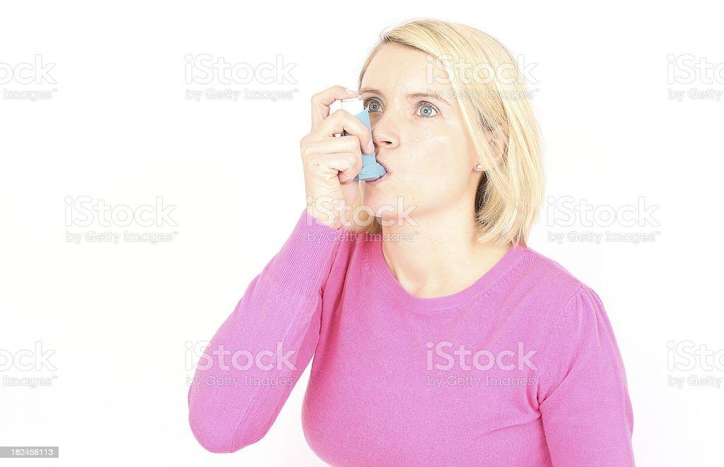 Taking Inhaler royalty-free stock photo
