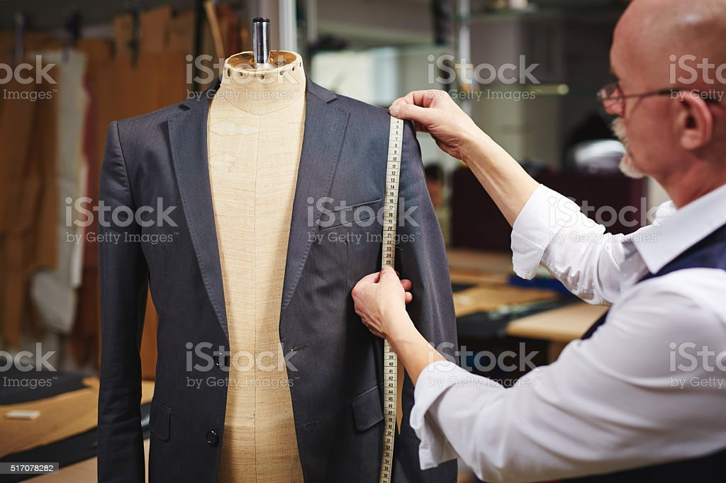 Taking measures from jacket stock photo