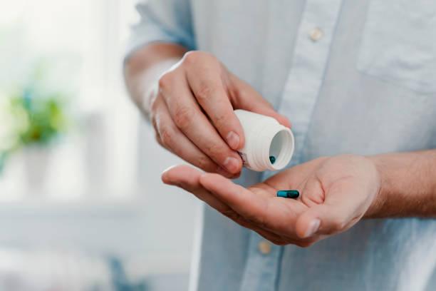 Prendre des médicaments à apporter un certain soulagement indispensable - Photo