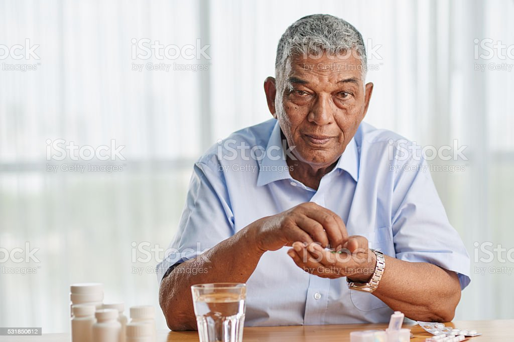 Taking medicine stock photo