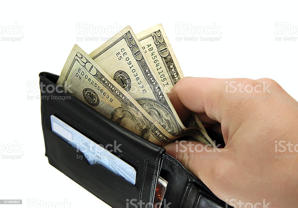 Taking money from wallet stock photo