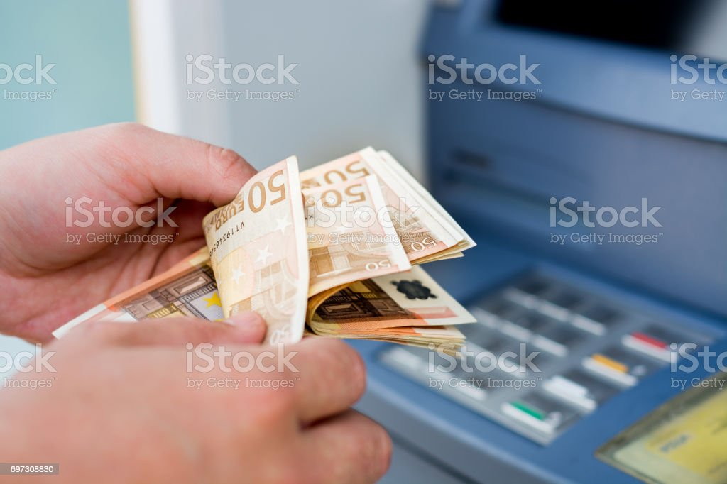 taking money out of the ATM stock photo