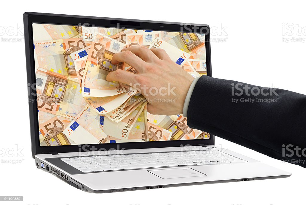 Taking money out of the screen stock photo