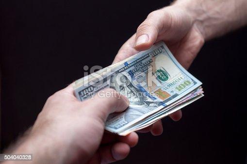 istock Taking money 504040328