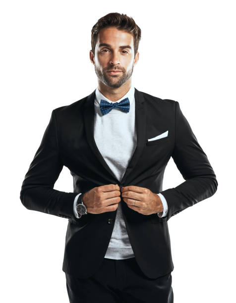 Taking my tux out for a spin Studio shot of a handsome young man wearing a tuxedo against a white background tuxedo stock pictures, royalty-free photos & images