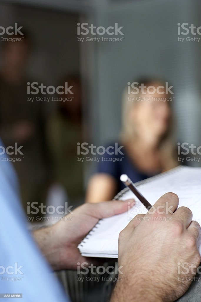 taking notes during a meeting royalty free stockfoto