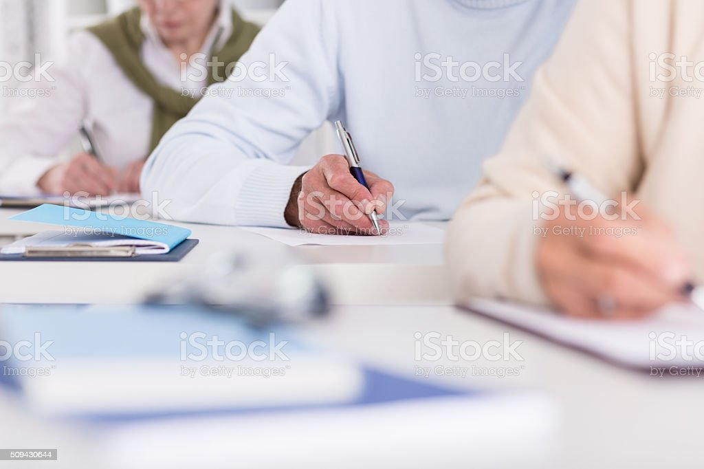 Taking notes from a lecture stock photo