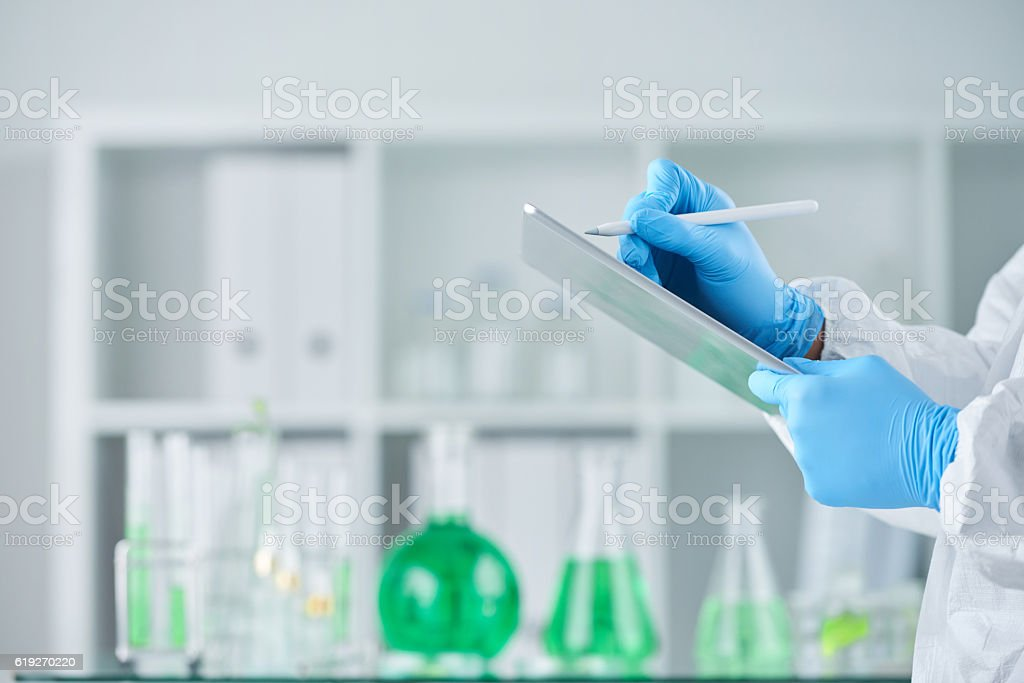 Taking notes on experiment stock photo