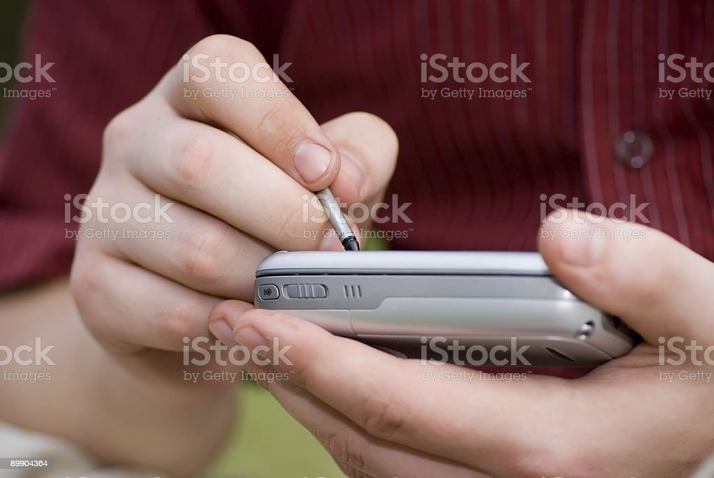 Taking notes on PDA royalty-free stock photo