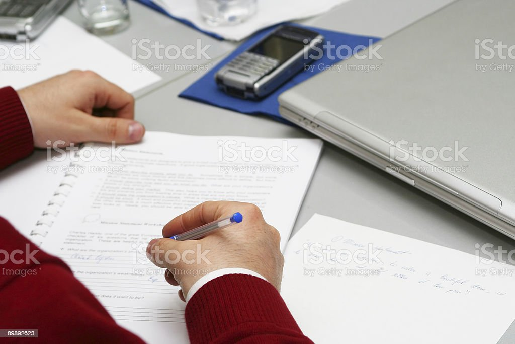 Taking notes on the meeting at boardroom royalty-free stock photo