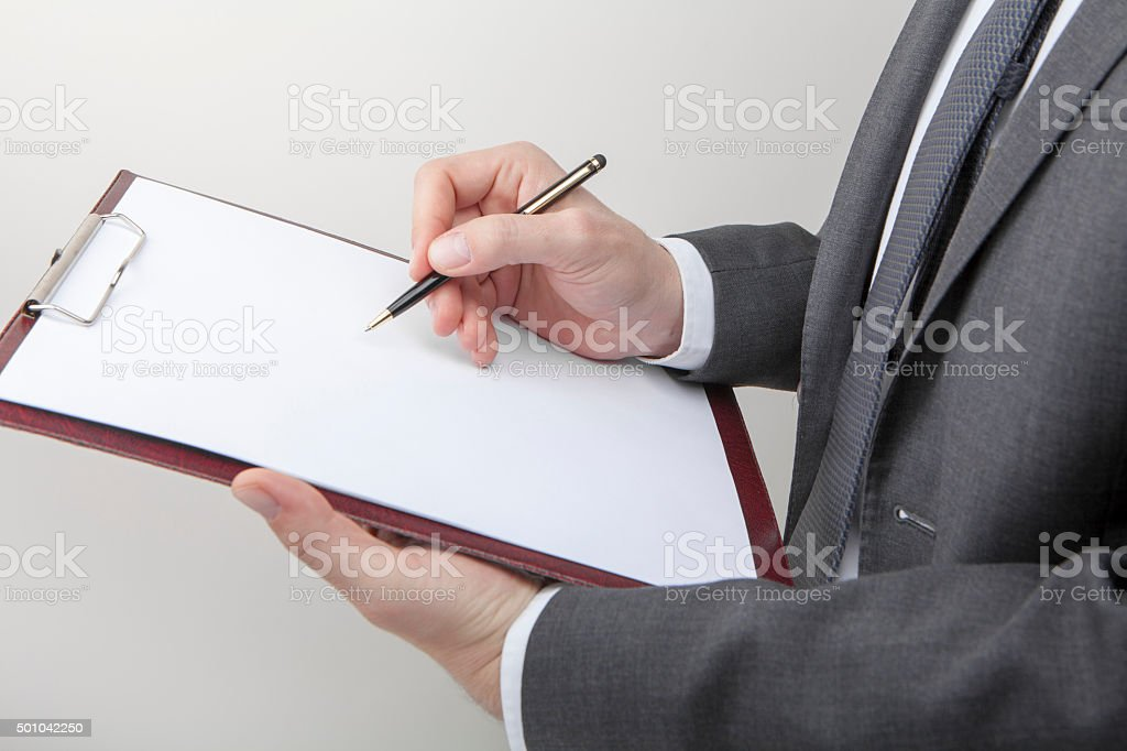 Taking notes stock photo
