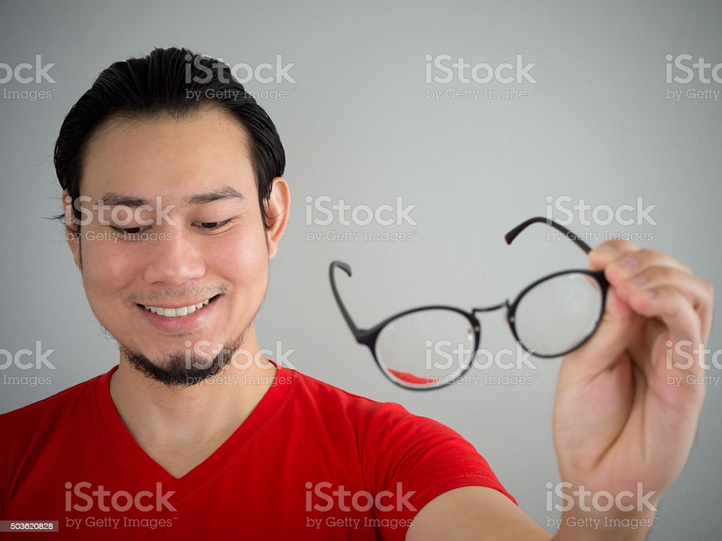 Taking off eyeglasses. stock photo
