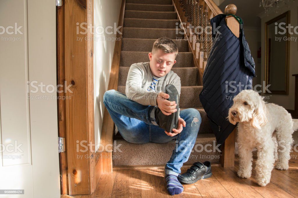 Taking off his Shoes stock photo