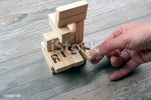 Taking one block from wooden blocks tower,risk managament