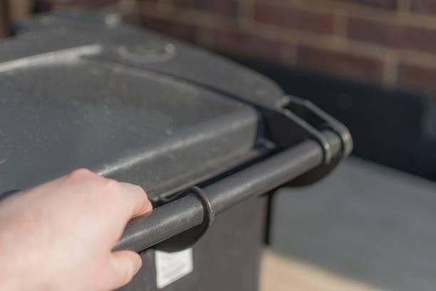 Taking out a wheelie bin stock photo