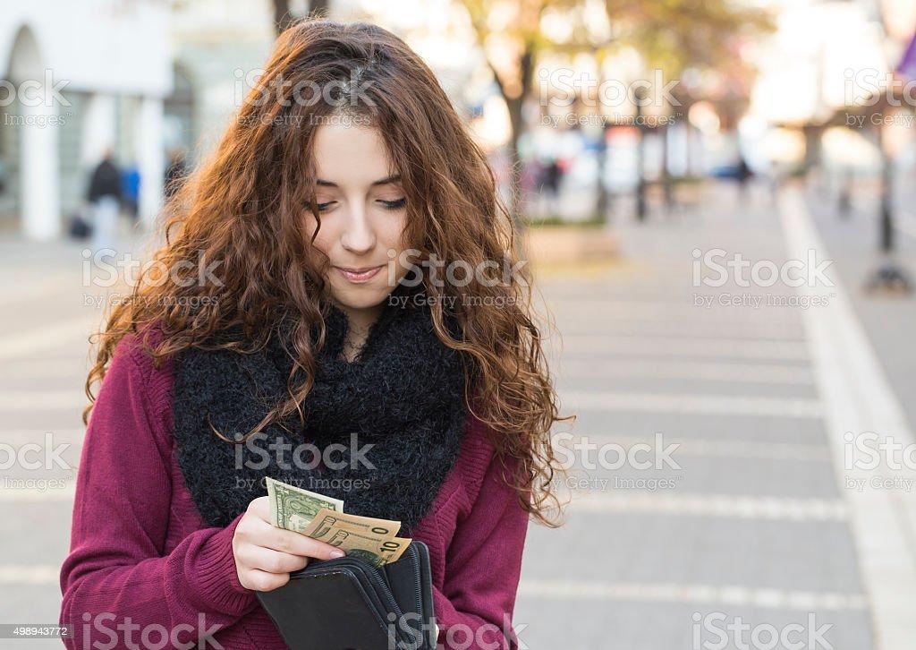 taking out dollar bills stock photo