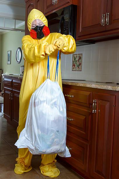 Taking out Haz Mat garbage stock photo