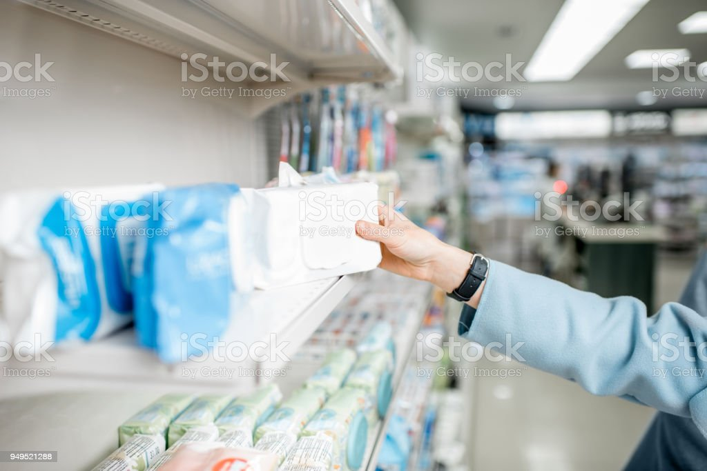 Taking packaging with wet wipes stock photo