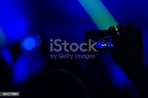 833314292 istock photo Taking photo at concert 454279887