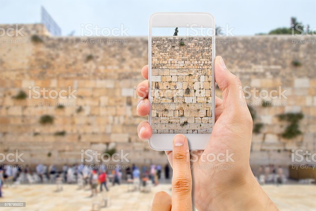 taking photo in the western wall of jerusalem stock photo