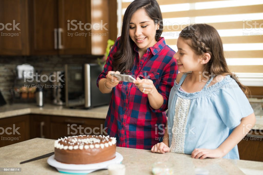 Taking photo of a cake they just baked stock photo