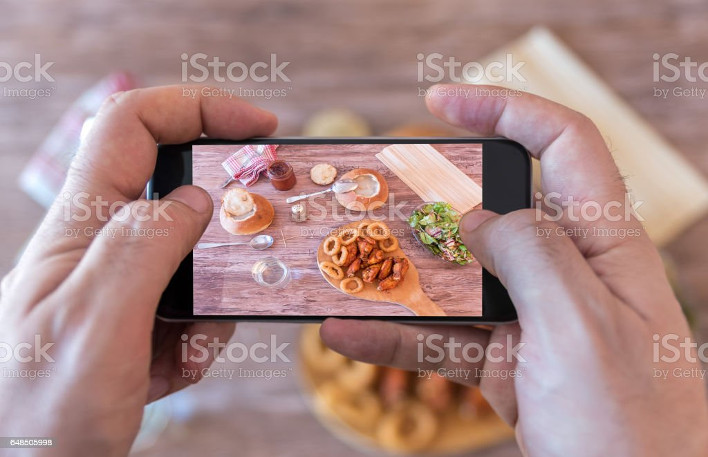 Taking photo of dinner stock photo