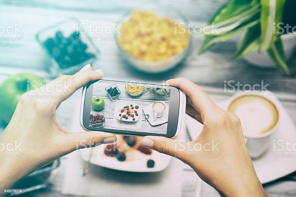 Taking photo of food with smart phone. stock photo