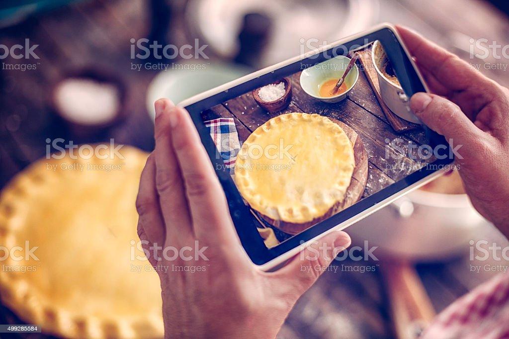 Taking Photo of Homemade Chicken Meat Pie stock photo