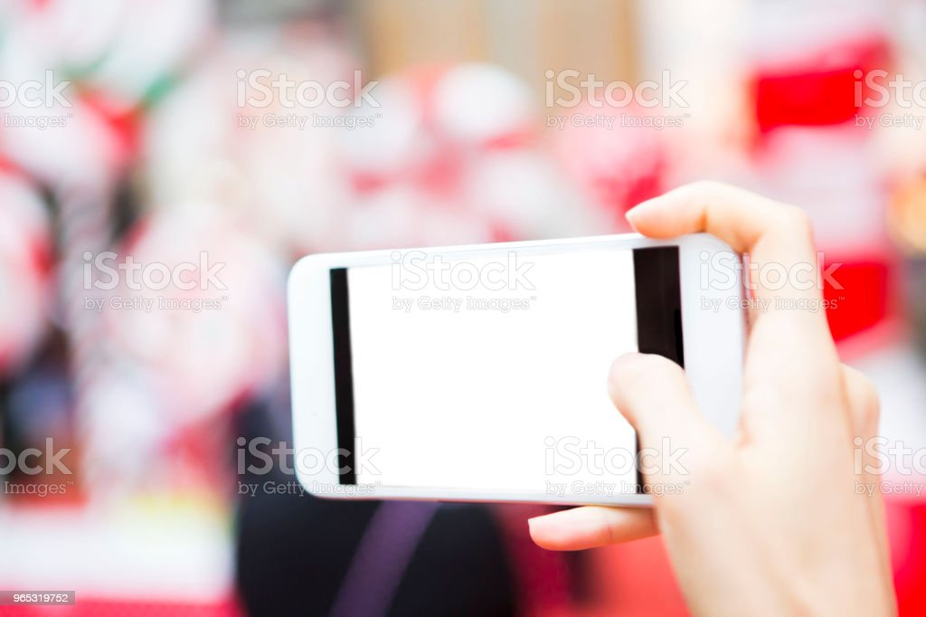 Taking photo with the new phone royalty-free stock photo