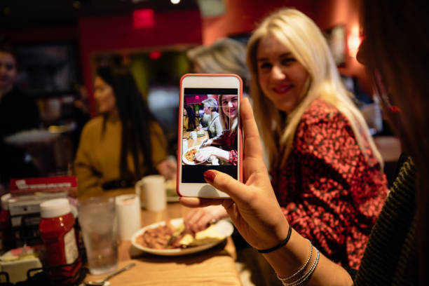 taking photos at dinner - foodie stock photos and pictures