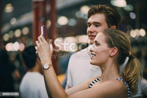 istock Taking Photos In Queen Victoria Market 699945090