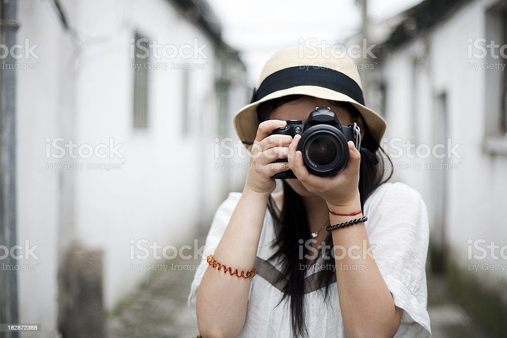 Taking photos with a DSLR stock photo