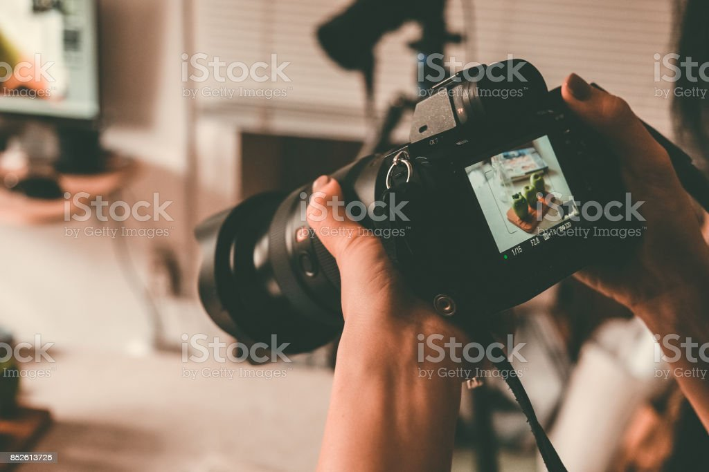 Taking photos with DSLR Camera stock photo