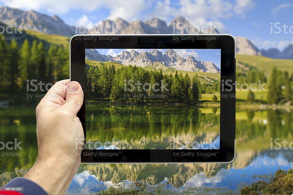 Taking picture at San Pellegrino Lake (Dolomites) stock photo