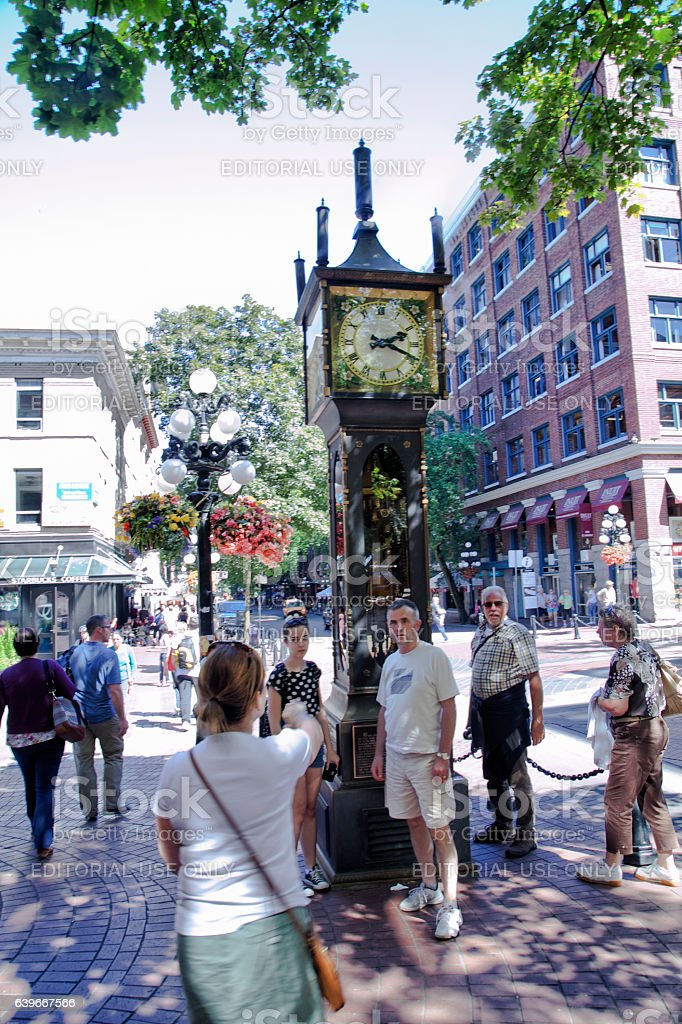 Taking picture in front of steam clock at Gastown,Vancouver stock photo