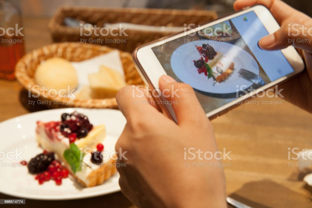 taking picture of cake royalty-free stock photo