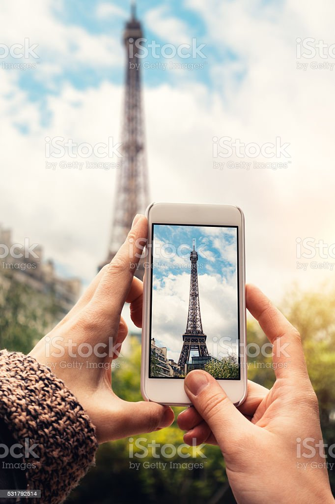 Taking Picture Of Eiffel Tower stock photo
