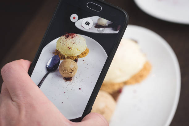 Taking picture of food  with phone stock photo
