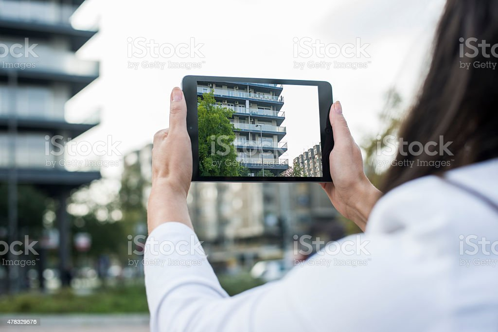 Taking picture with Ipad mini stock photo