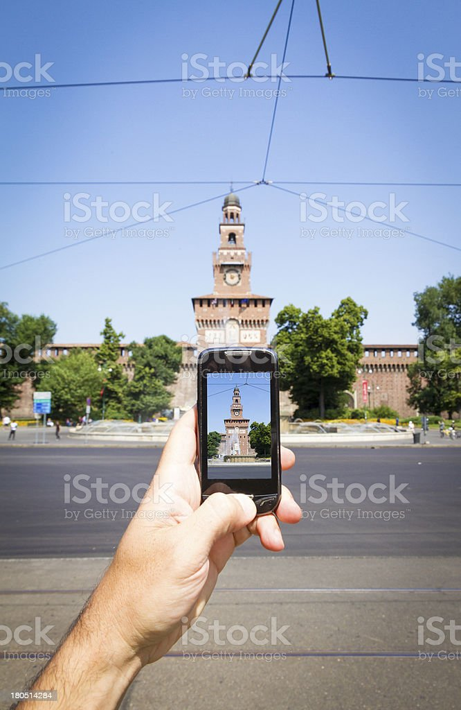Taking picture with smart phone in Milan stock photo