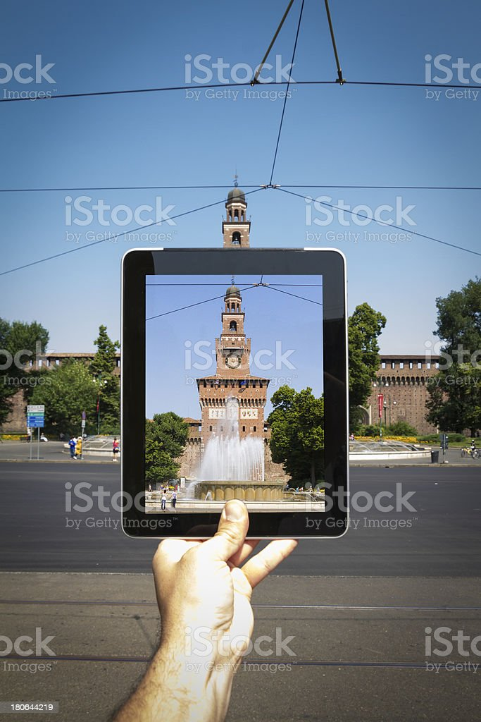 Taking picture with tablet in Milan stock photo